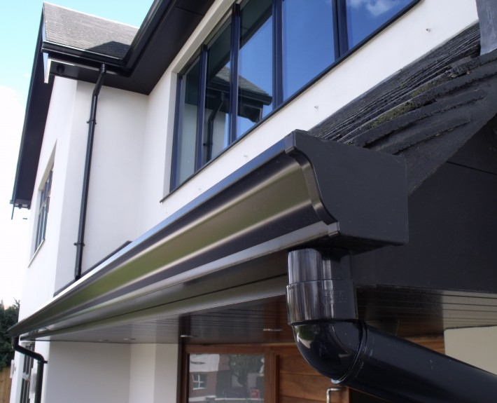 Close-up of Seamless Aluminium Gutter and PVC Drain Pipe