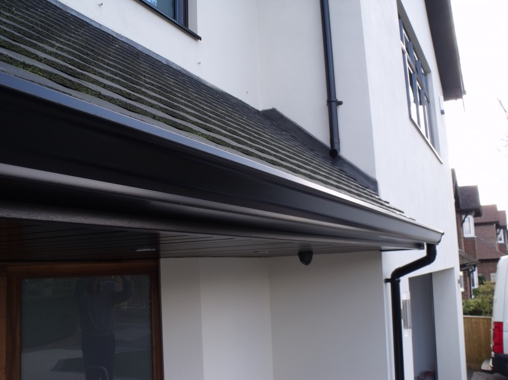 Installation Of Black Fascias Soffits And Seamless