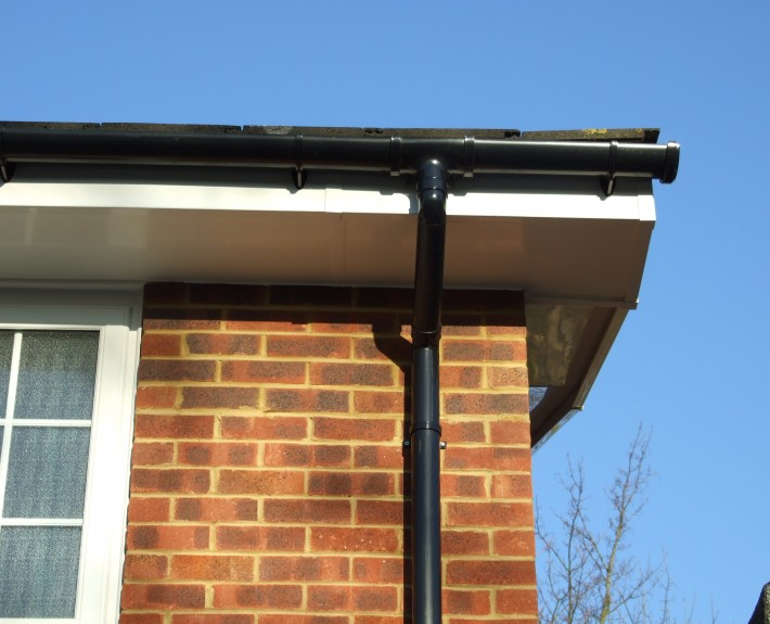 White UPVC Fascias and Ventialted Soffits with Black PVC Gutter and Downpipes