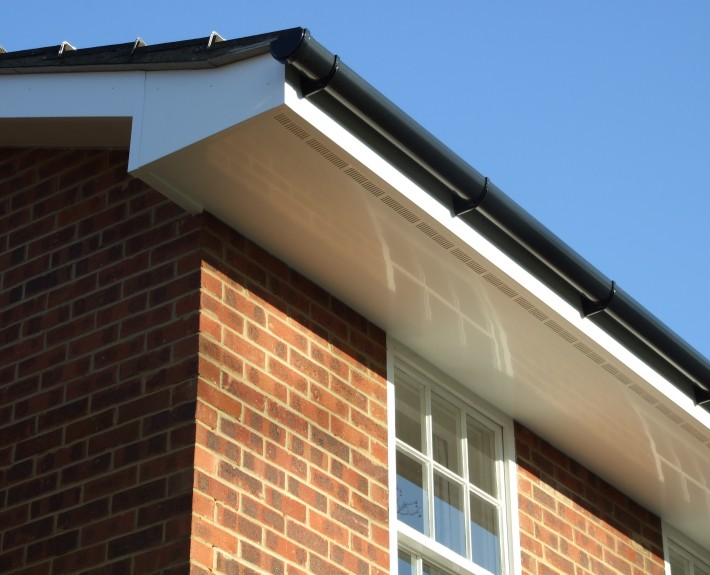 White UPVC Ventilated Soffit with Black PVC Guttering Long Shot