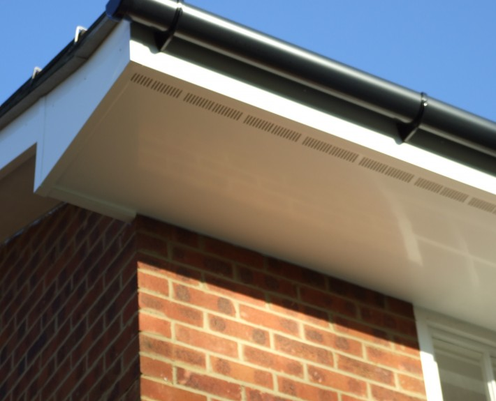 White UPVC Ventilated Soffit with Black PVC Guttering