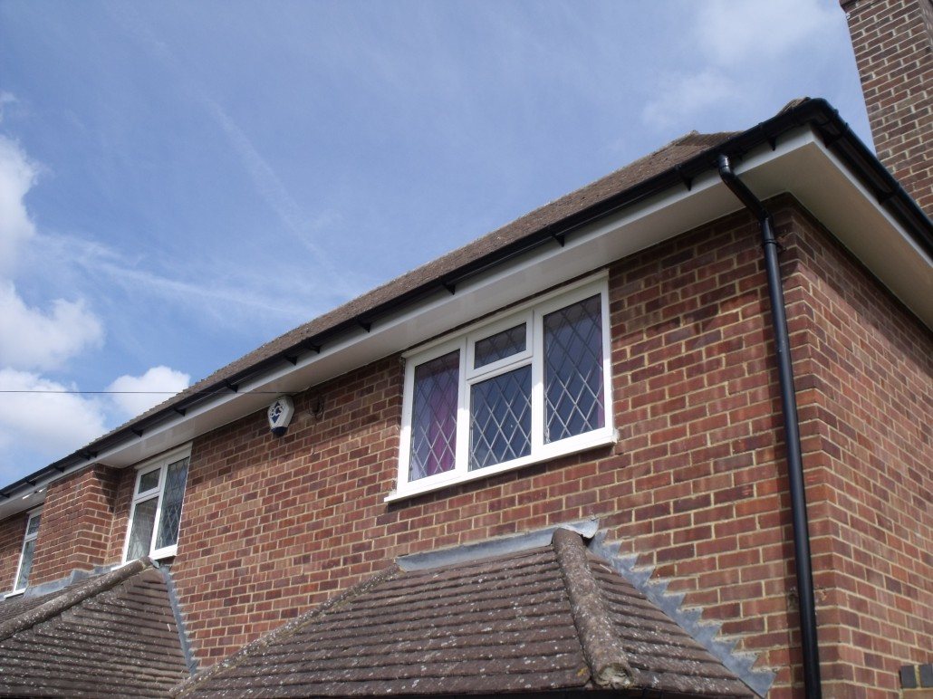 Installation of Black PVC Guttering and White UPVC Barge