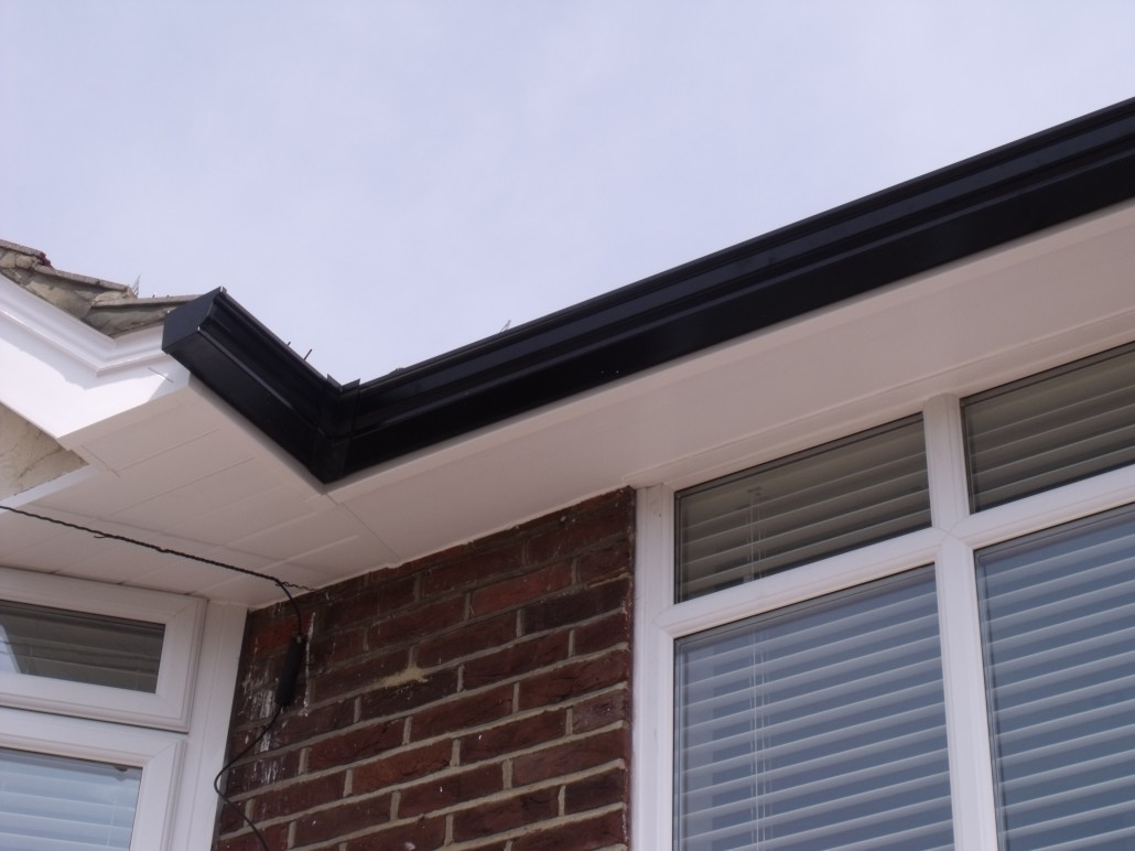 Installation Of Black Seamless Aluminium Guttering With