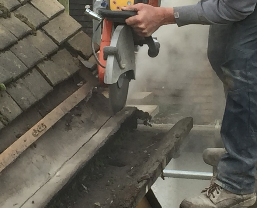 Cutting front section of Concrete Gutters