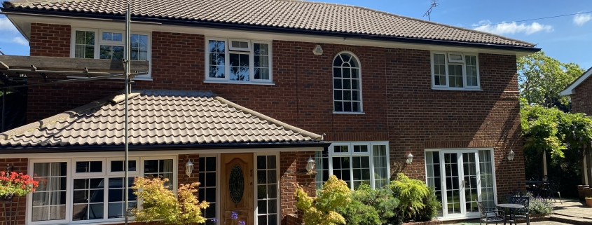 White Fascias and Soffits with Black Seamless Aluminium Gutters in Leatherhead Surrey 3