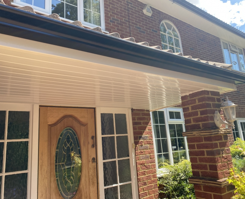 White Fascias and Soffits with Black Seamless Aluminium Gutters in Leatherhead Surrey 4